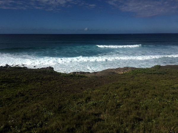 Surf rolling in at Ka'ena Point