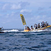Single Outrigger Race - this is one of the Heiva events. The paddlers are almost swamped by the accompanying boats.