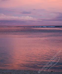 Rarotonga - pink sunset over lagoon