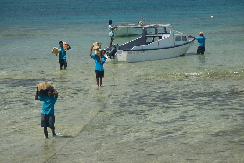 Unloading stuff from boat - Yasawa Islands, Fiji