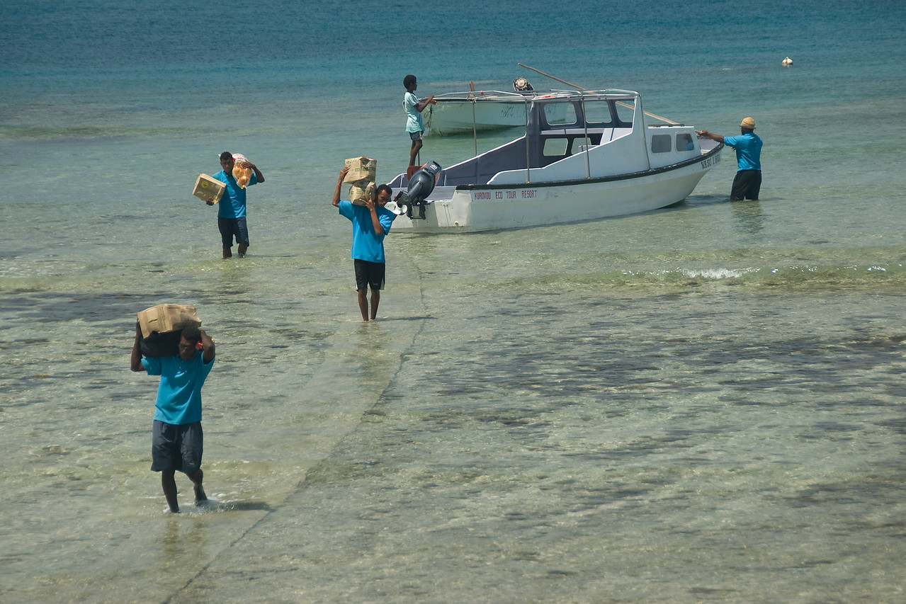 Unloading stuff from boat - Yasawa Islands, Fiji