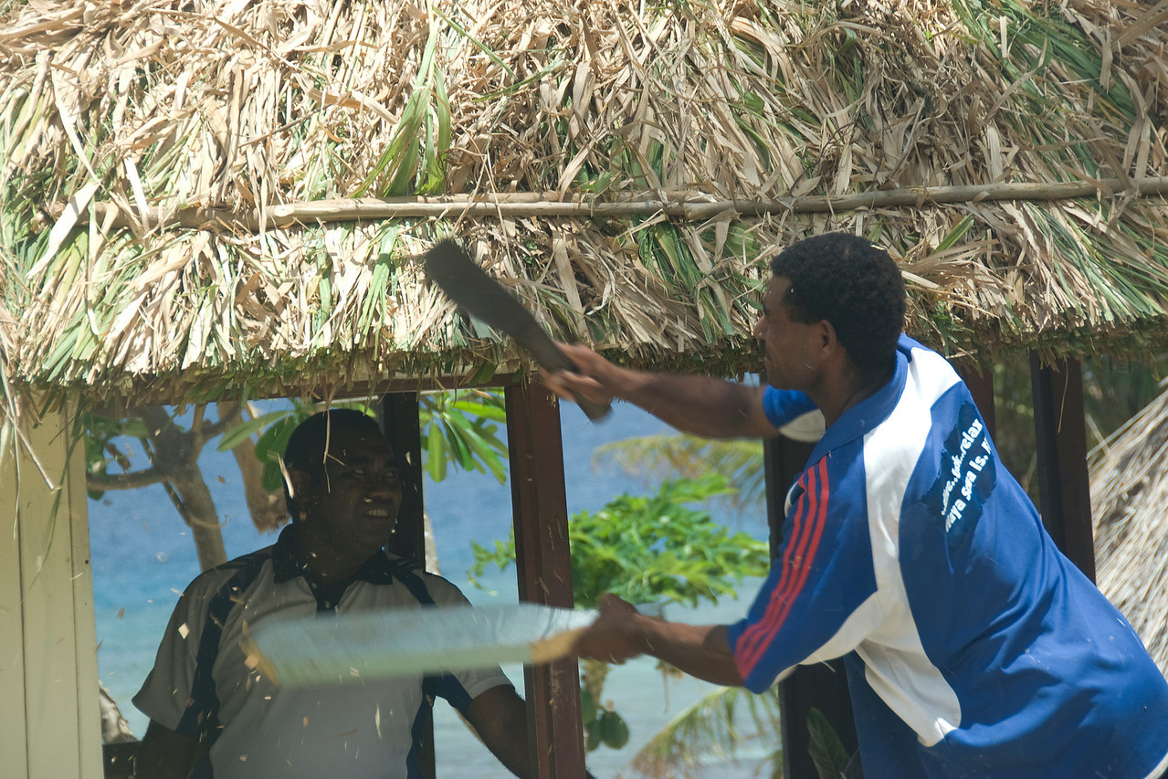 Man fixing a hut - Yasawa Islands, Fiji