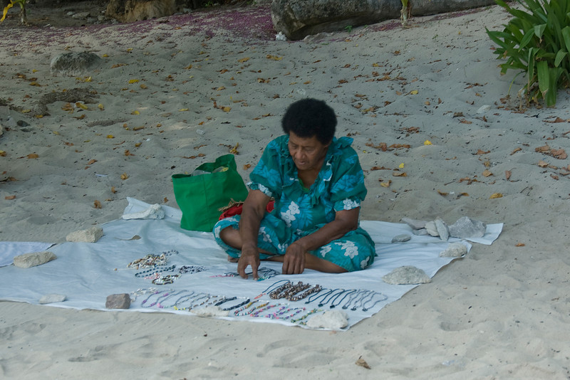 Woman selling handcrafts on the beach - Yasawa Islands, Fiji