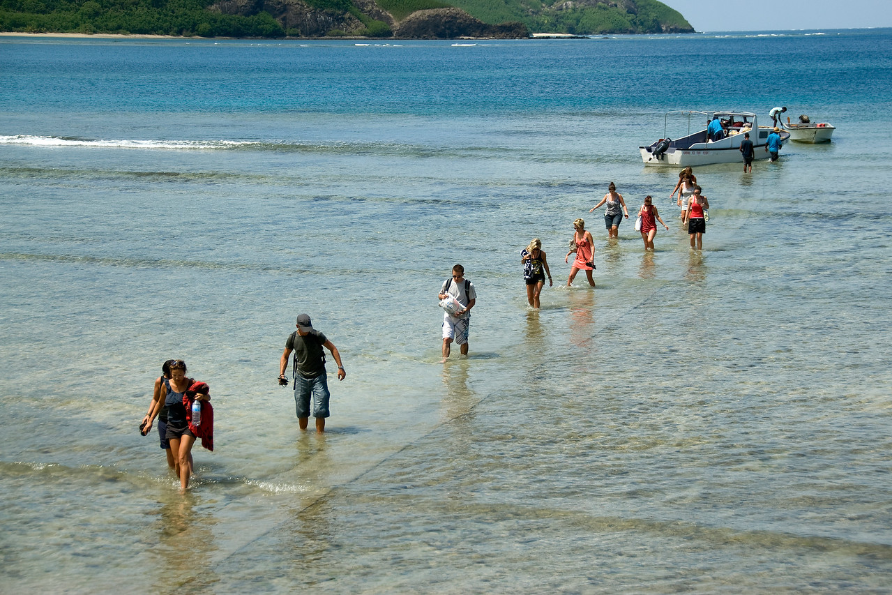 Tourists walking to the beach - Yasawa Islands, Fiji