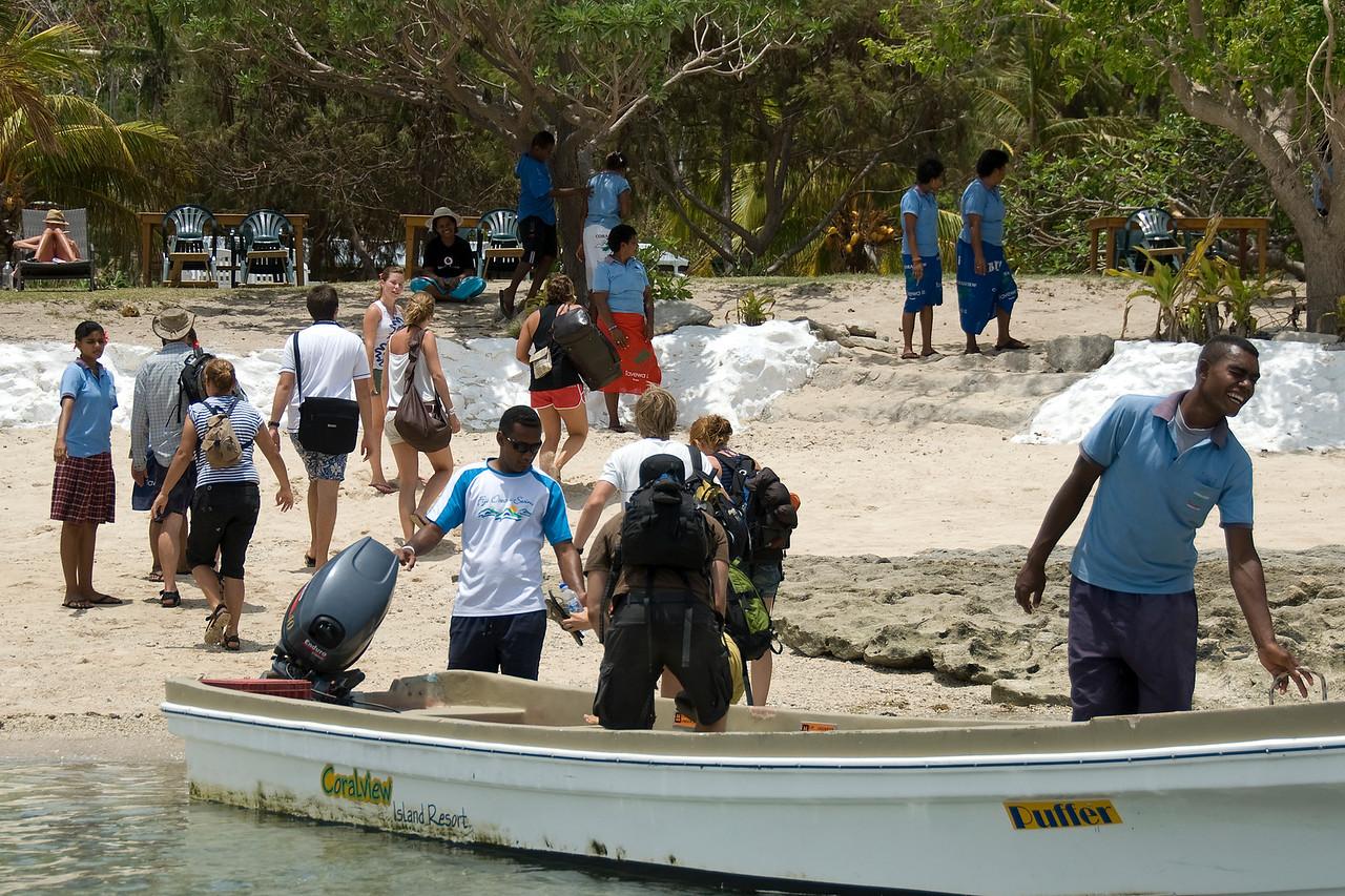 Tourists on a beach in Yasawa Islands, Fiji
