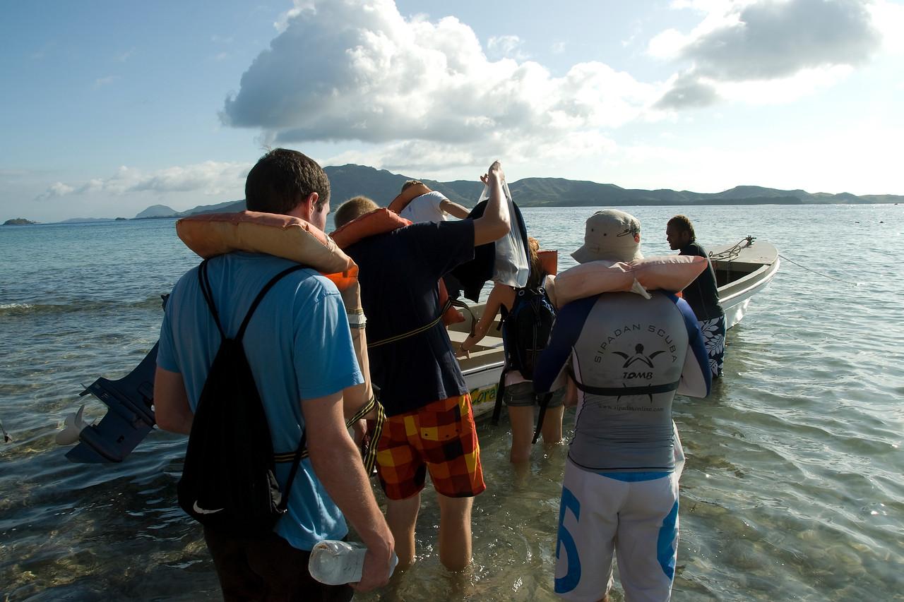 Tourists hopping onto boat - Yasawa Islands, Fiji