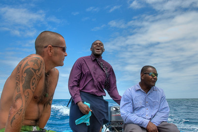 Men riding the boat in Yasawa Island - Fiji