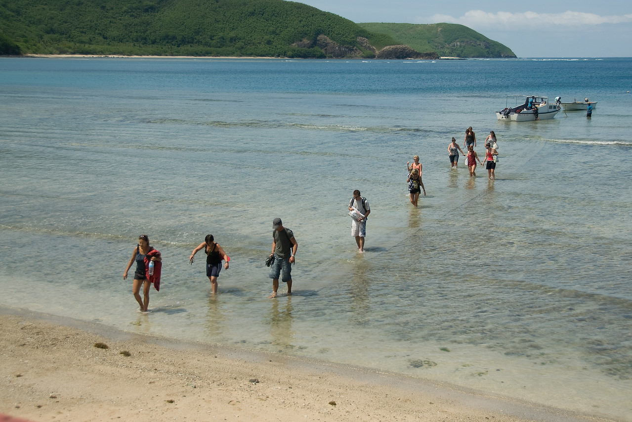 Tourists walking towards the beach - Yasawa Islands, Fiji