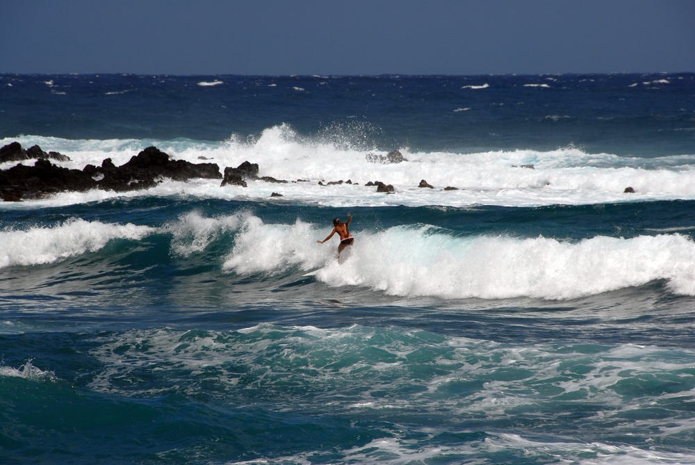 Woman surfing in Maui, Hawaii