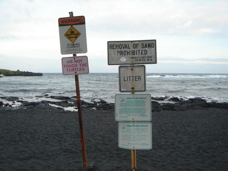 Signs at Punalu'u Black Sand Beach Park, Hawaii