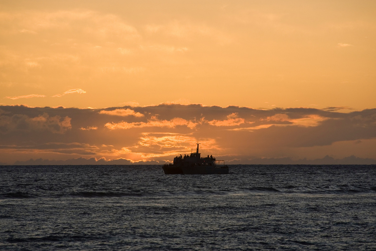 Boat off lahaina at sunset