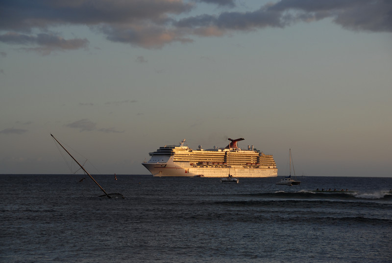 Ship cruising during sunset in Lahaina, Hawaii