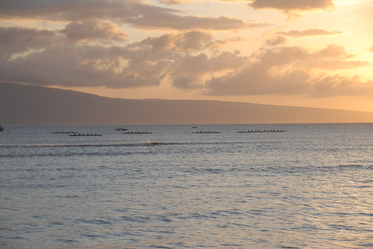 Canoers during sunset in Lahaina, Hawaii
