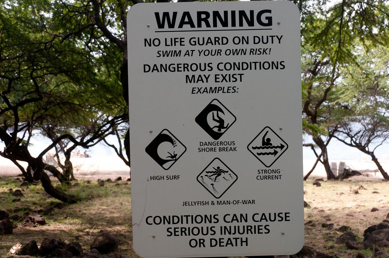 Warning signs near the beach in Lanai, Hawaii