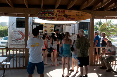 Tourists lining up on a food truck in Oahu, Hawaii