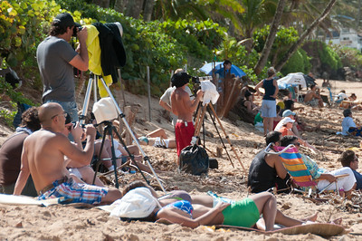 Tourists and photographers on the beach of Oahu, Hawaii