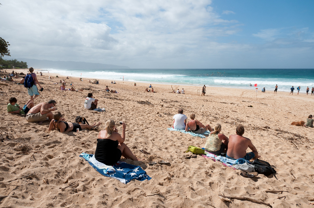 Tourists on the beach in Oahu, Hawaii