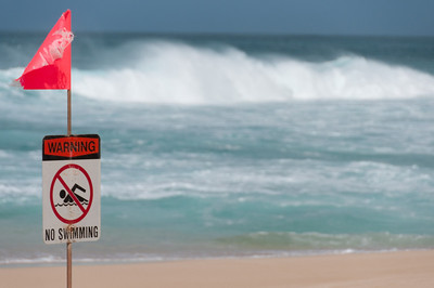 No swimming sign on the beach of Oahu, Hawaii