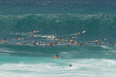 Group of surfers on the Pacific of Oahu, Hawaii