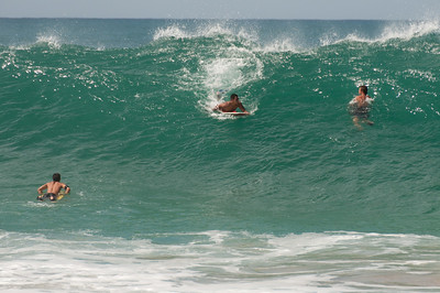Surfers on the Pacific of Oahu, Hawaii