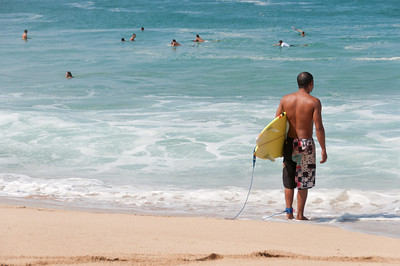 Surfers on the beach of Oahu, Hawaii