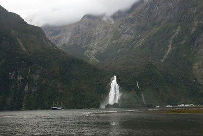 Boat and Waterfall in Milford Sound
