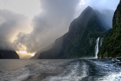 A waterfall at sunset - Milford Sound, New Zealand