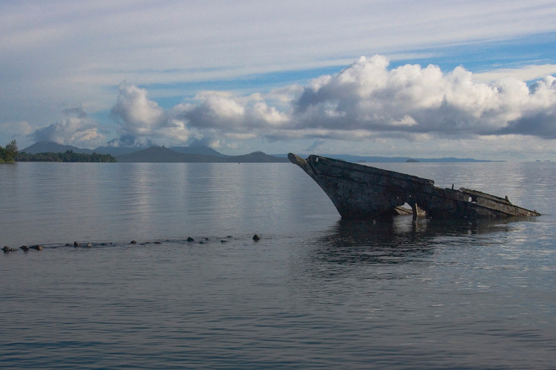 Volcano and Sunken Boat In Kimbe Bay - West New Britain, Papua New Guinea