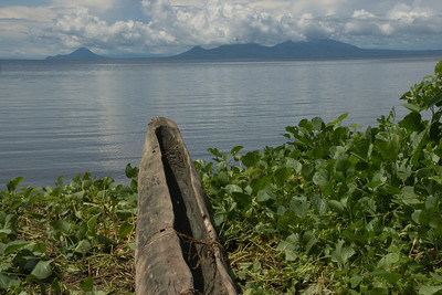 Volcano and Canoe In Kimbe Bay 1 - West New Britain, Papua New Guinea