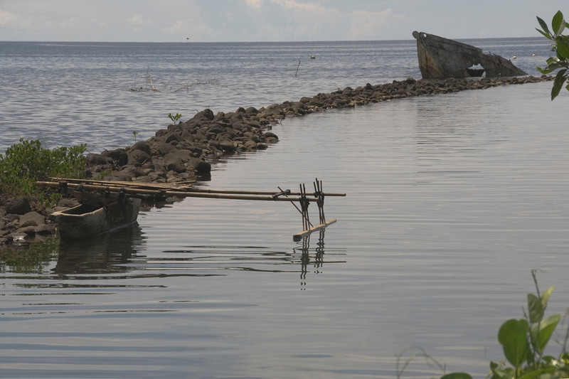 Canoe and Sunken Boat - West New Britain, Papua New Guinea