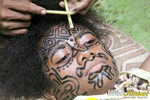Korafe women doing facial tattoo