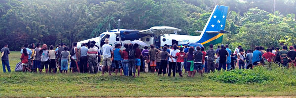 Crowd at Plane, Rennel Island - Solomon Islands