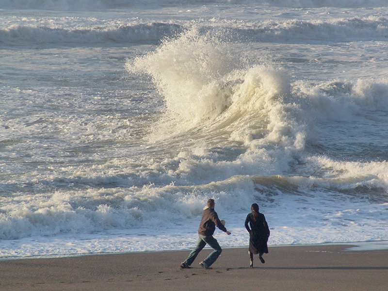 Northern end of Rockaway Beach. There is a very bad rip or under current that can create these huge waves that suddenly pop up, then disappear. These people were caught unawares...