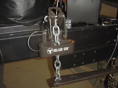 Slide the chain sway return loop (the section wth blue Ox) over the tightener bracket.