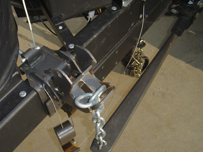 This shows the extra links at the end of the chain that is connected to the tightener bracket.