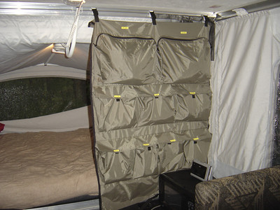 Unfasten the camper caddy buckles from the roof, roll it up and place in the TV.