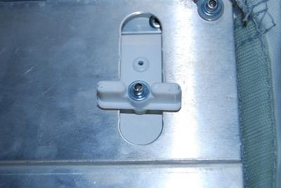 Twist both locking tabs 90 degrees and remove the door from the door way.