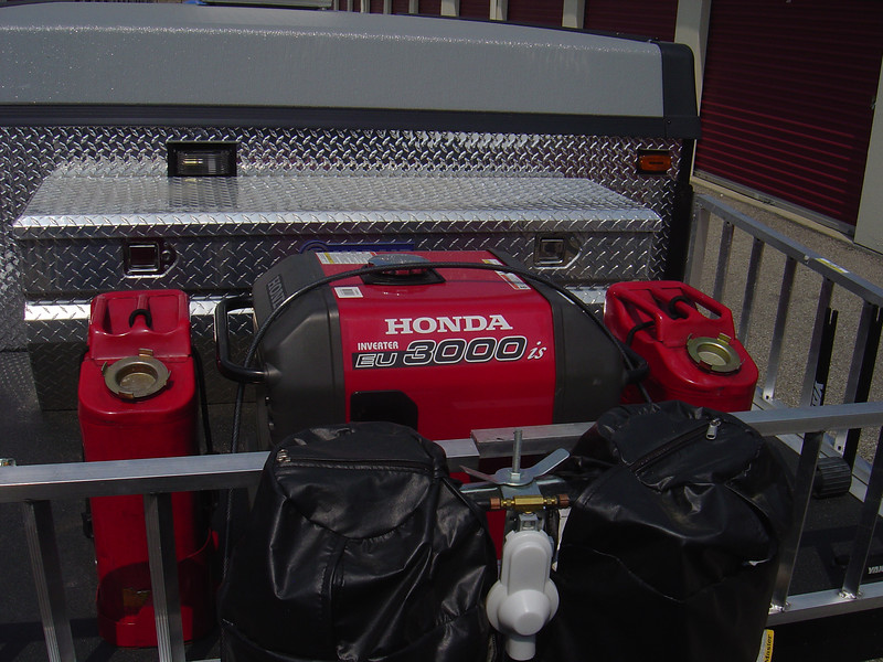 Honda generator EU 3000is and two gerry gas cans