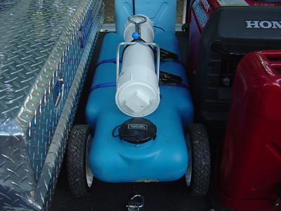 Gray water tank and hose storage