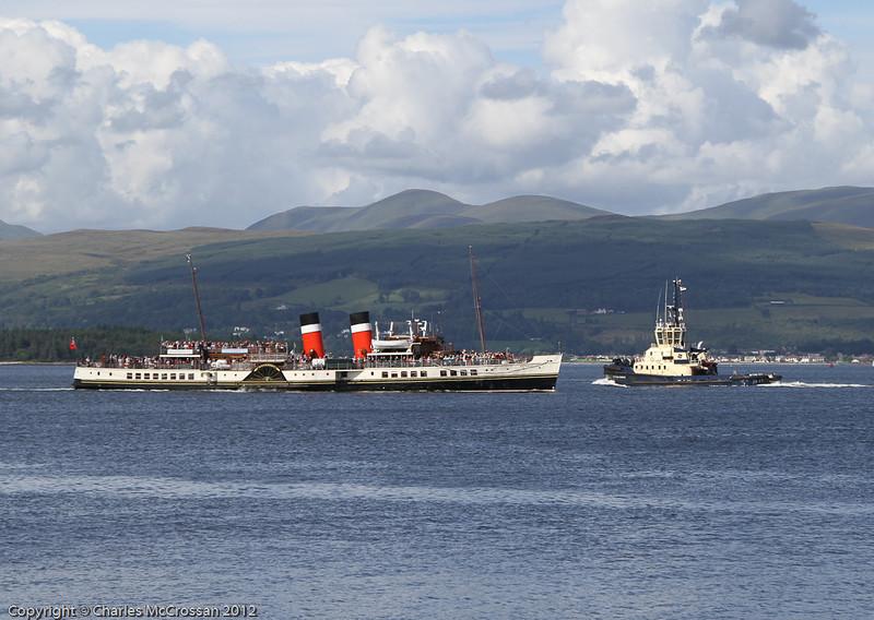 PS Waverley on her escort cruise for Cunarder Queen Elizabeth passing tug Ayton Cross