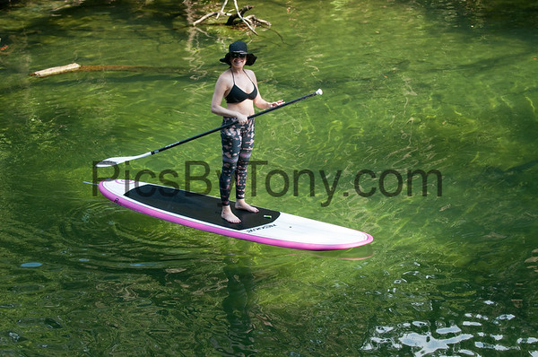 Paddle Boarding Couple in Blue Spring State Park in Orange City on June, 26 2016
