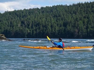 Kayaker passing Reef on Tumbo Island