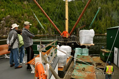 Offloading Supplies at a Fish Farm