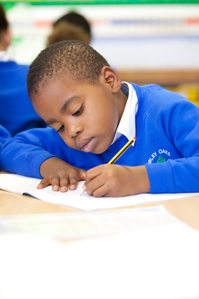 Child writing in a lesson