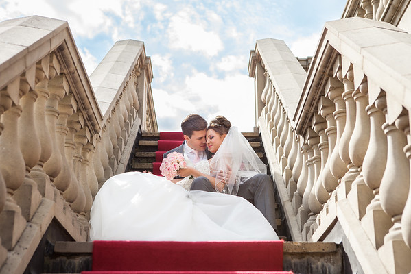 Bride and groom formal portrait on the grand staircase at Woldingham Golf Club