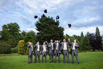 Groom and Groomsmen throwing their top hats into the sky