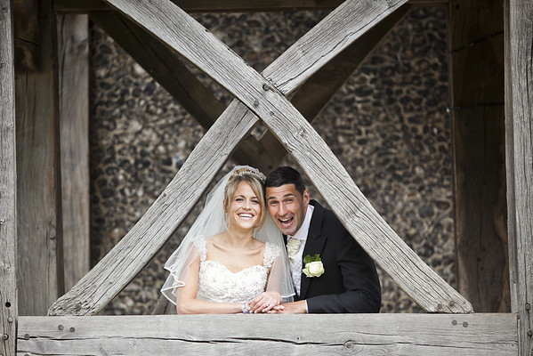 Fun photograph of a bride and groom near St Mary's Church in Beddington