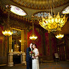 Formal portrait of a bride and groom in the music room at the Royal Pavilion in Brighton