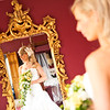 Bride portrait standing in front of a mirror
