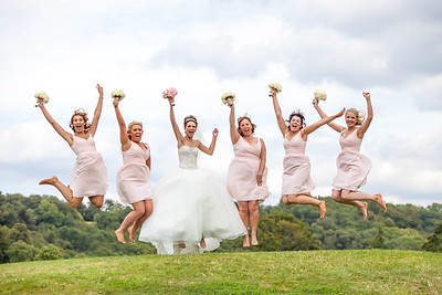 Bride and Bridesmaids jumping for joy at wedding